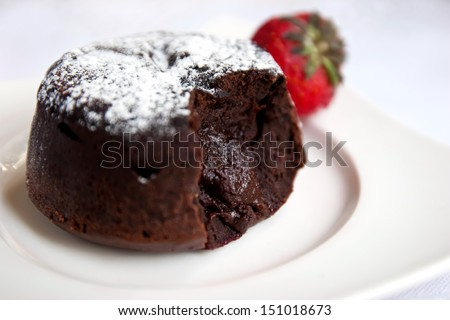 Delicious chocolate fondant with syrup close-up