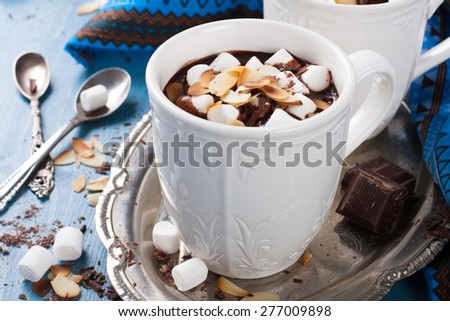 Delicious chocolate milk made from almond milk with marshmallow and almond chips. Selective focus. - stock photo