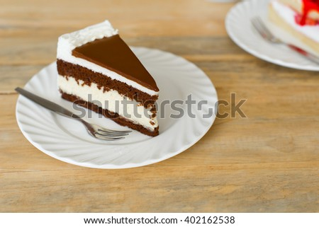 Delicious chocolate mousse cake on plate.   - stock photo