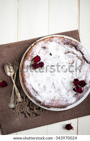 Delicious Chocolate Nut Torte on White Plate with Red Dried Roses