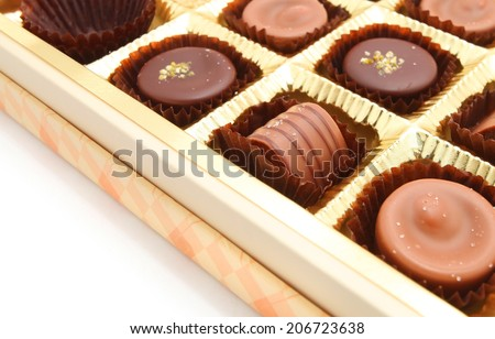 Delicious chocolate pralines in a box isolated on white background  - stock photo