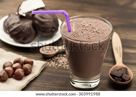 delicious chocolate shake with heart on wooden background. Cocktail, smoothies - stock photo