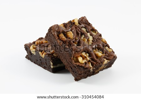 Delicious chocolate walnut brownies on white background - stock photo