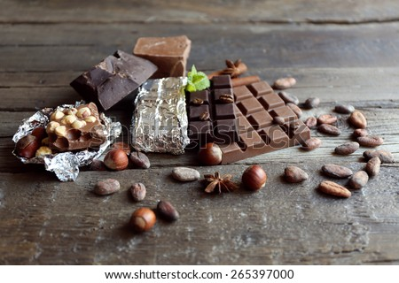 Delicious chocolate with spices on wooden table, closeup - stock photo