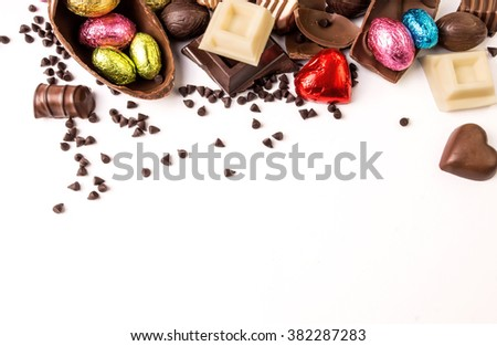 Delicious chocolates and easter egg on a white background.