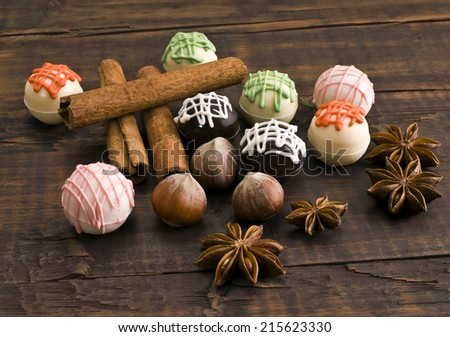 Delicious chocolates and spices - stock photo