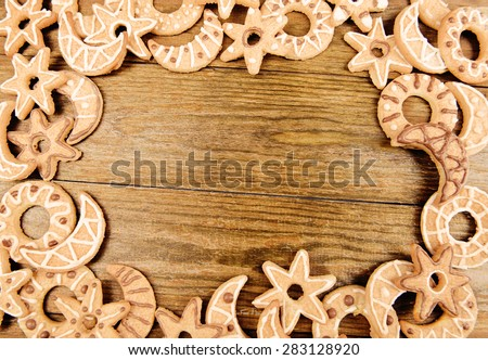 Delicious Christmas cookies on wooden background - stock photo