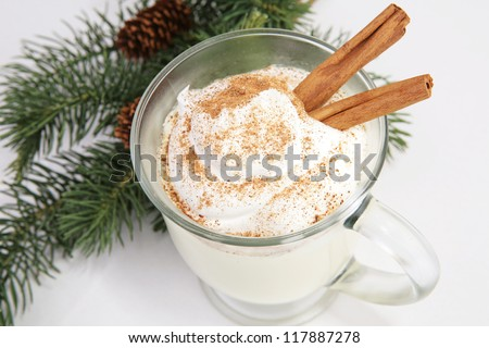 Delicious Christmas eggnog, with whipped cream, nutmeg, and cinnamon. - stock photo