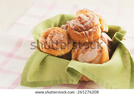 Delicious cinnamon buns with glaze  icing, soft pastel tones - stock photo