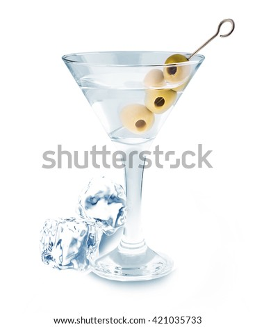 Delicious cocktail with olives and ice cubes in martini glass on a white background.