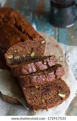 Delicious coffee and date cake with pistachio and cranberries