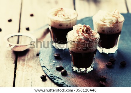 Delicious coffee with crean and cocoa, selective focus and toned image - stock photo