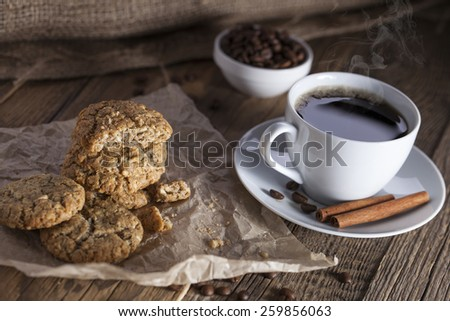 Delicious coffee with sweets on a wooden table, studio shoot
