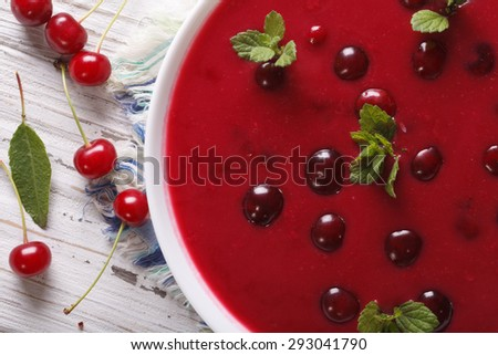 delicious cold cherry soup in a bowl on a table macro. horizontal top view  - stock photo