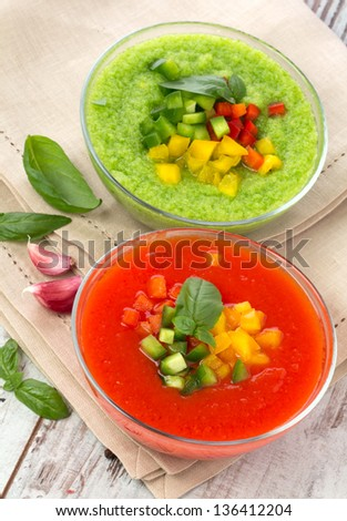 Delicious cold red and green gazpacho soup  in  bowls - stock photo