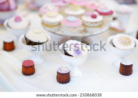 Delicious colorful cupcakes for wedding reception or other event party - stock photo
