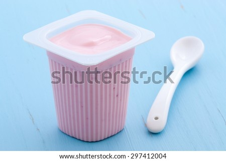 Delicious commercial french custard-style yogurt with all the fruit mixed inside during the process. On vintage retro styling.