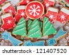 Delicious cookies with Christmas shapes in a red basket - stock photo