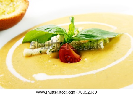 Delicious Cream soup with crackers - stock photo