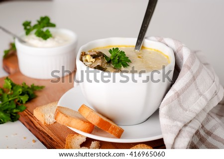delicious creamy soup with croutons and greens on Boards
