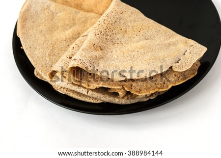Delicious crepes on a plate. Selective focus. White background. Healthy spelt and oatmeal flour vegan crepes. - stock photo
