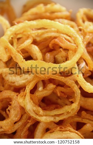 Delicious crispy onion rings fried in batter ready to serve. - stock photo