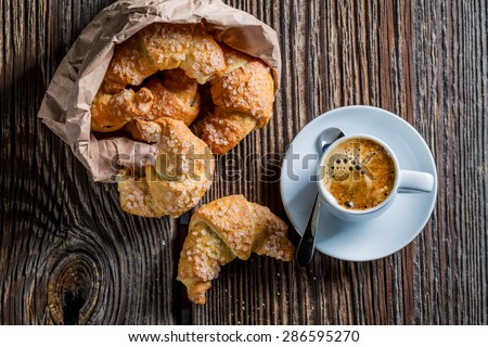 Delicious croissant and coffee for breakfast - stock photo