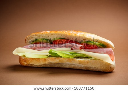 Delicious crusty baguette sandwich with ham - stock photo