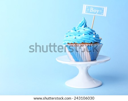 Delicious cupcake with inscription on blue background - stock photo