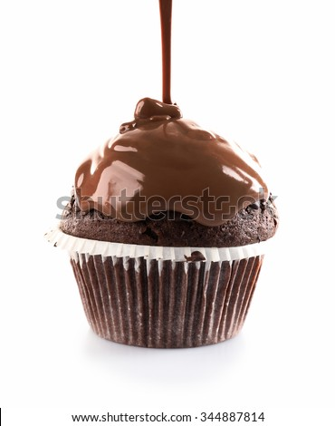 Delicious cupcake with melted chocolate topping, isolated on white - stock photo