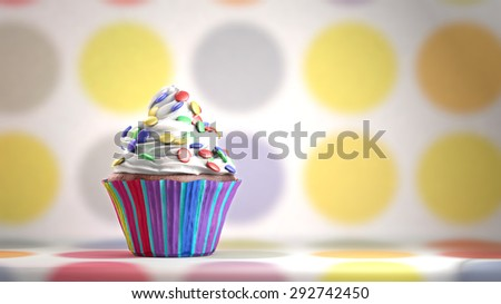 Delicious cupcake with smarties on a whipped cream. Colored disks background. Copy space - stock photo