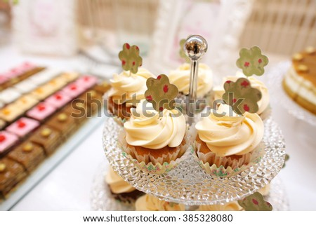 Delicious cupcakes on candy bar