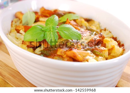 delicious curry chicken casserole with cauliflower, potato,green paprika and eggs - stock photo