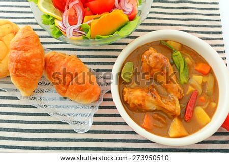 Delicious curry with salad - stock photo