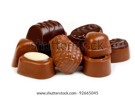 Delicious dark and milk chocolate pralines - stock photo