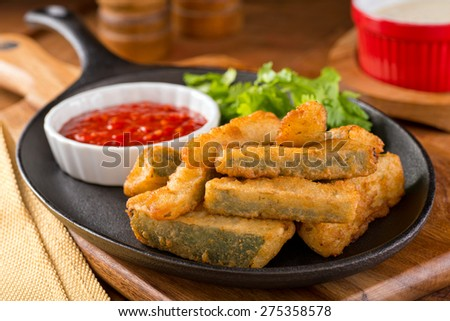 Delicious deep fried zucchini sticks with marinara dipping sauce. - stock photo