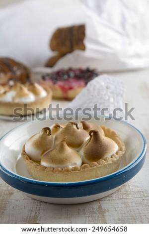 Delicious dessert of lemon pie, table set for breakfast - stock photo