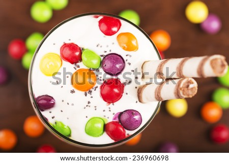 Delicious dessert with colorful candies in the bowl - stock photo