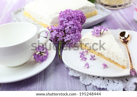 Delicious dessert with lilac flowers  - stock photo