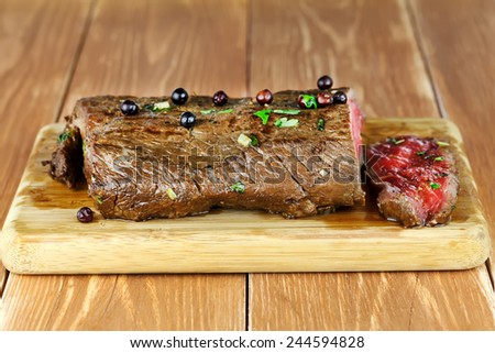 Delicious dinner of rare roast beef - stock photo