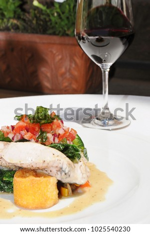 Delicious dinner with Fish and red wine
