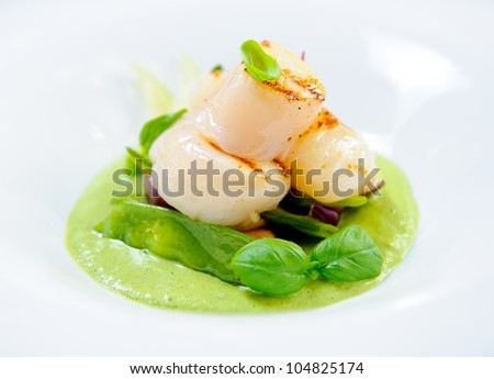 Delicious dish with fish fillet and green curry on a plate - stock photo