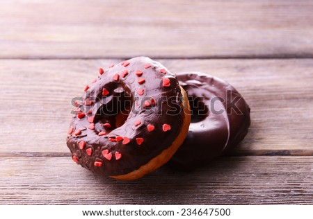 Delicious donuts with glaze on table close-up - stock photo
