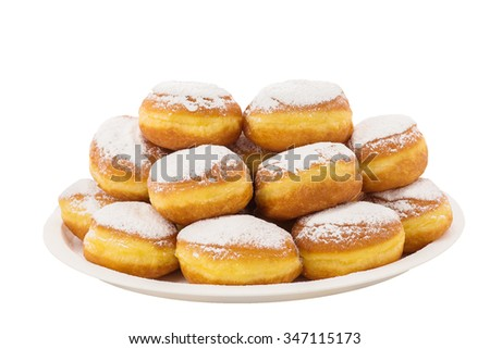 Delicious donuts with powdered sugar on top and chocolate filling on a plate