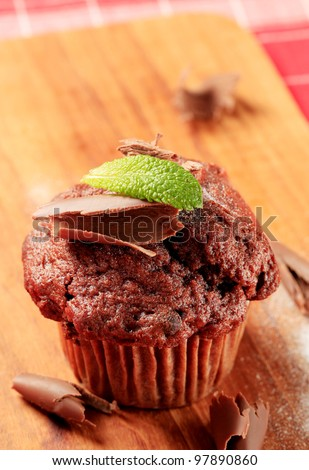 Delicious double chocolate muffin on cutting board