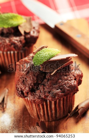 Delicious double chocolate muffins on cutting board
