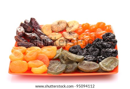delicious dried fruits on plate isolated on white