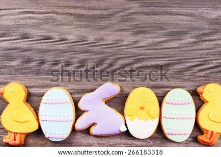 Delicious Easter cookies on wooden background - stock photo