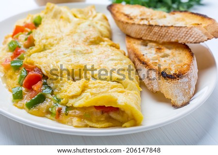 Delicious Egg Omelette with Vegetables on the Plate
