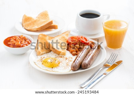 delicious English breakfast with sausages, horizontal - stock photo